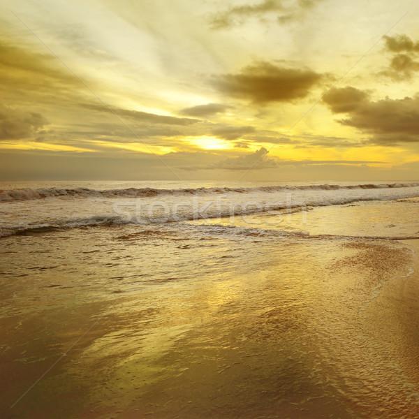 Nascer do sol oceano belo céu água nuvens Foto stock © serg64