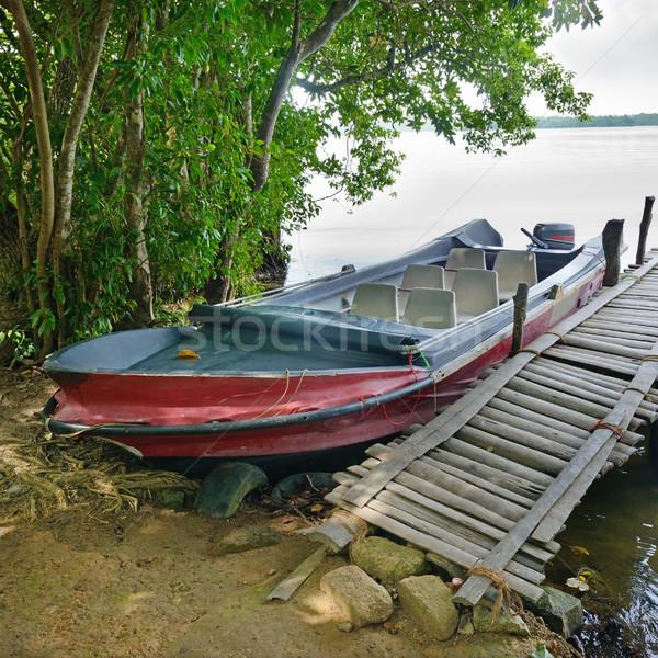 моторная лодка док реке банка пляж небе Сток-фото © serg64