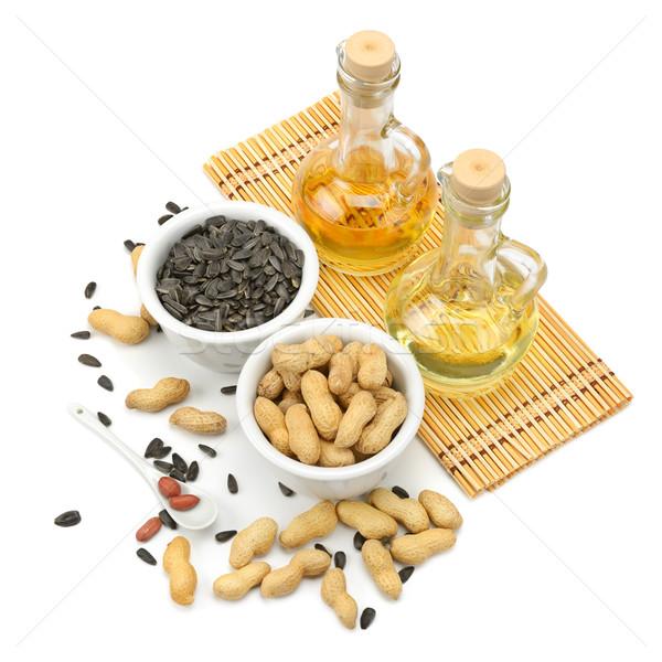 Zonnebloem zaden pinda's olie geïsoleerd witte Stockfoto © Serg64