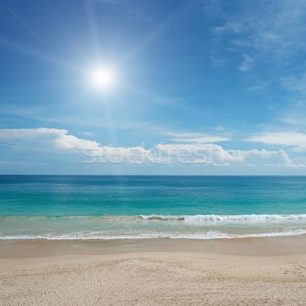 Zandstrand zon blauwe hemel hemel water wolken Stockfoto © serg64