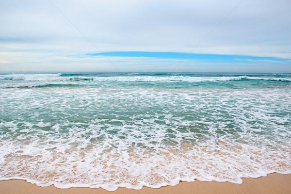 Golven zee Geel zand water wolken Stockfoto © serg64