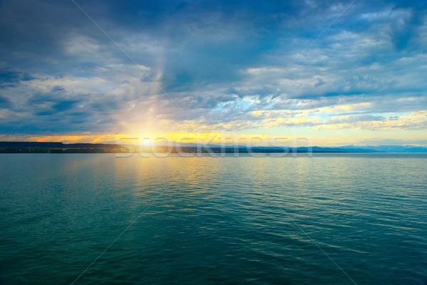 All'alba sopra mare cielo blu bianco nubi Foto d'archivio © serg64