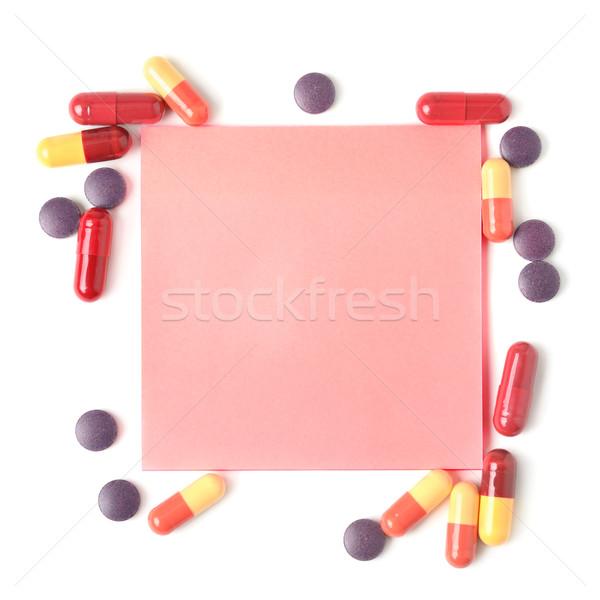Coloré pilules papier note isolé blanche Photo stock © Serg64