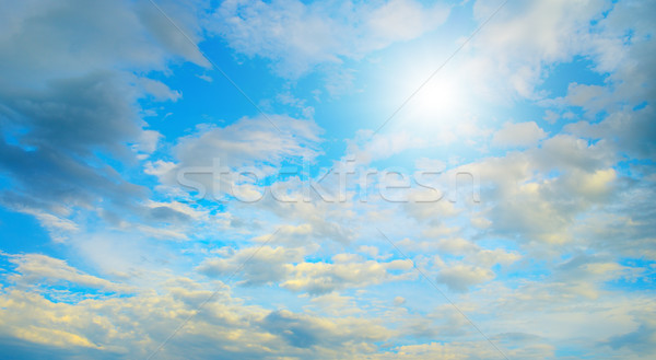 Sun in blue sky and white clouds. Stock photo © serg64