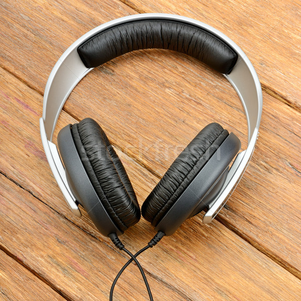 Big headphones on wooden table Stock photo © serg64