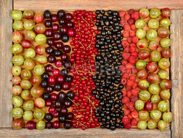 (currants, gooseberries, raspberries, plums) on wooden backgroun Stock photo © serg64