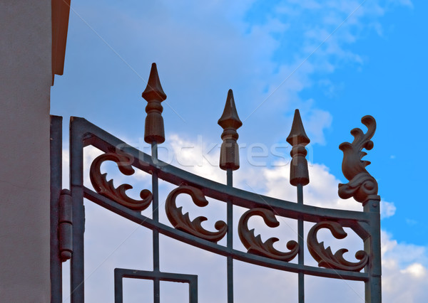 Wrought iron gate against blue sky Stock photo © serge001