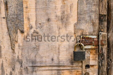 Old wooden door with rusty latch and padlock Stock photo © serge001