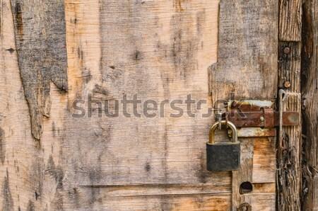 öreg fából készült ajtó rozsdás lakat kopott Stock fotó © serge001
