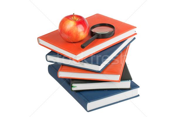 Maturo mela lente di ingrandimento libri isolato Foto d'archivio © serpla