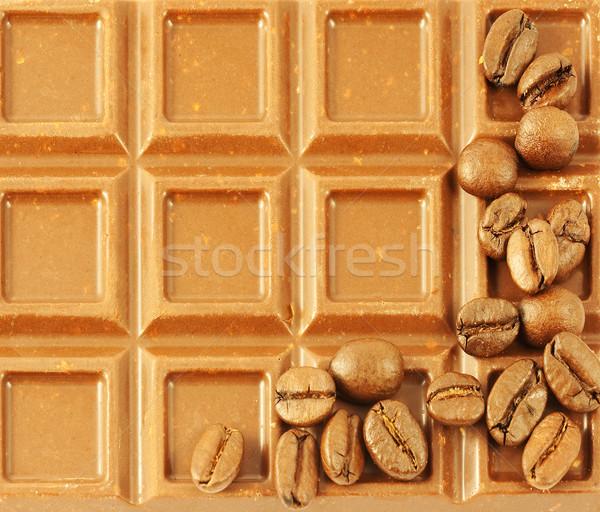 Primo piano chicchi di caffè latte sfondo candy Foto d'archivio © serpla