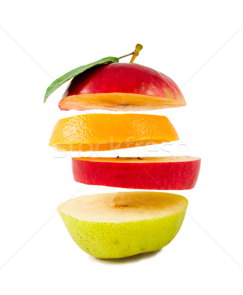 Stock photo: Composition of different fruit flying slices isolated on white