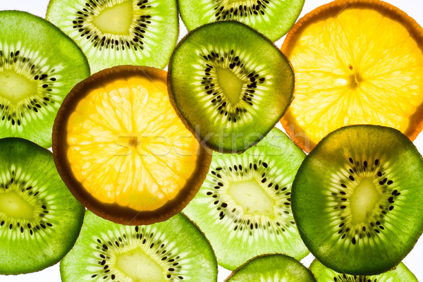 Kiwi fruit and orange in backlight Stock photo © serpla