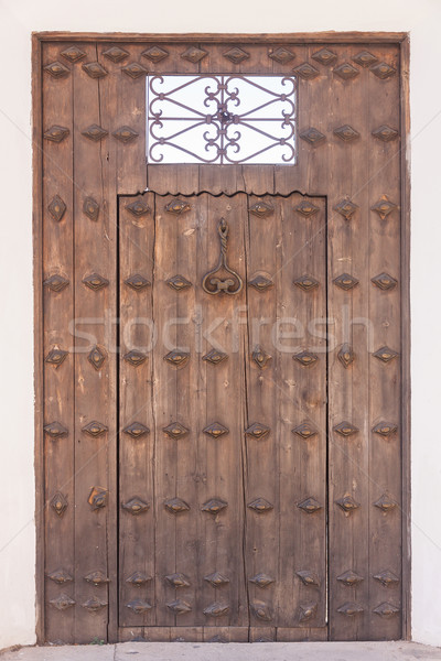 Old wooden door with handle Stock photo © serpla