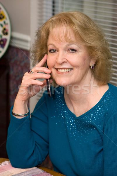Senior Talks Cellphone Stock photo © sframe