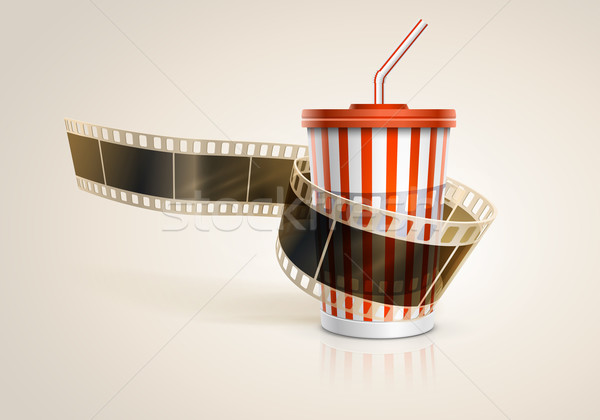 Stock photo: Camera film roll and cardboard cup with a straw.