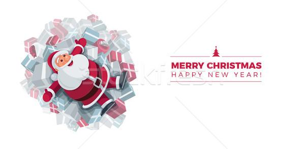 Santa Claus on gift boxes design Stock photo © sgursozlu