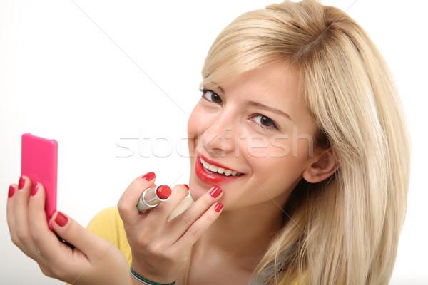 Smiling blonde doing make up Stock photo © shamtor