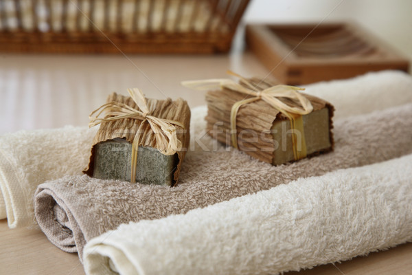 Soaps with towels and natural basket Stock photo © shamtor
