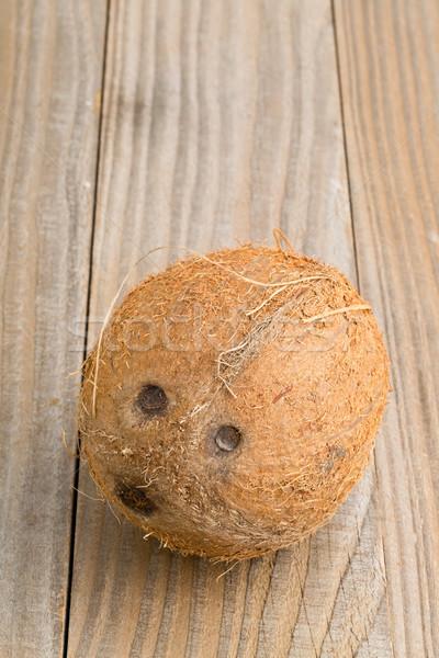 Whole coconut on table Stock photo © ShawnHempel