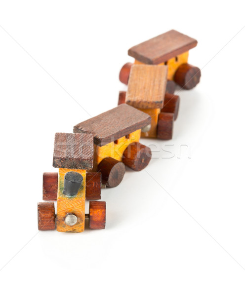 Wooden toy train with locomotive and wagons on white background Stock photo © ShawnHempel
