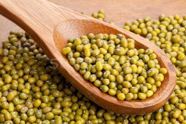 Raw mung beans on spoon Stock photo © ShawnHempel