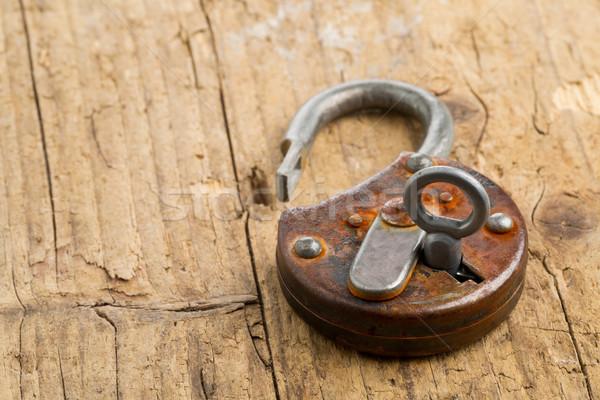 Open antique padlock with key in lock Stock photo © ShawnHempel
