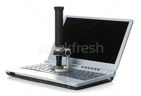 Historical old microscope on laptop computer keyboard Stock photo © ShawnHempel