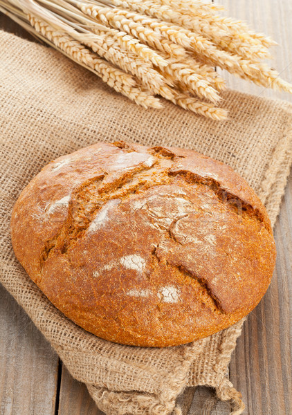 Loaf of bread with wheat ears Stock photo © ShawnHempel