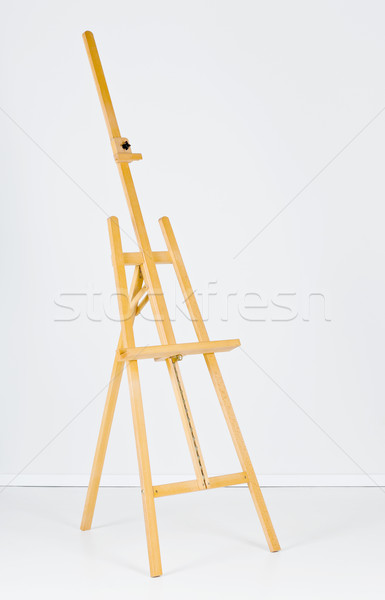 Wooden easel in white room Stock photo © ShawnHempel
