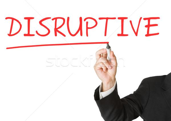 'Disruptive' written on whiteboard by businessman with marker Stock photo © ShawnHempel