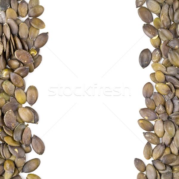Unshelled pumpkin seeds border Stock photo © ShawnHempel