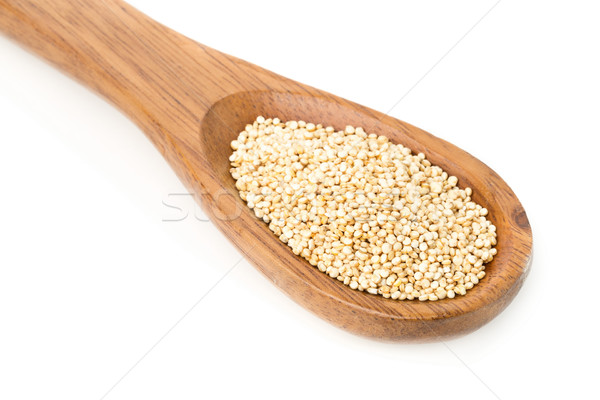 Raw, uncooked, whole quinoa seed in wooden spoon Stock photo © ShawnHempel