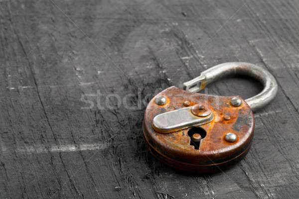 Open antique padlock on black Stock photo © ShawnHempel