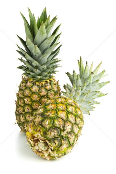 Two whole pineapple fruit on white background Stock photo © ShawnHempel