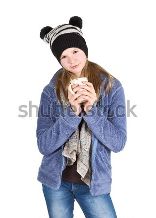 Young girl with jacket and wooly hat holding cup  Stock photo © ShawnHempel