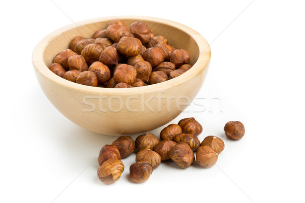 Cracked and shelled hazelnut in wooden bowl Stock photo © ShawnHempel