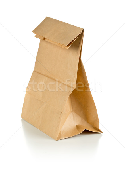 Recycled brown paper doggy bag over white background Stock photo © ShawnHempel