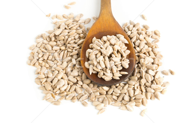 Shelled sunflower seeds in wooden spoon Stock photo © ShawnHempel