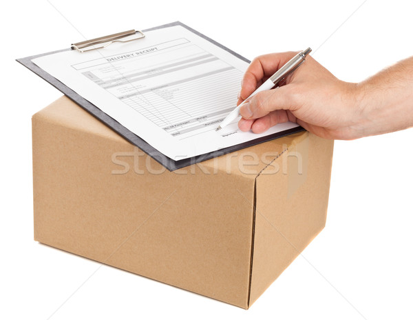 Pakketdienst man ondertekening levering vorm Stockfoto © ShawnHempel