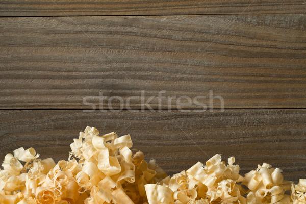 Light brown wood shavings from carpenter's hand planer or chisel Stock photo © ShawnHempel