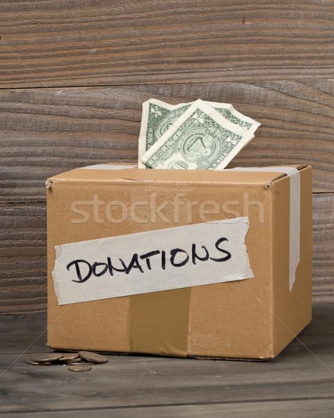 Schenking dollar bankbiljetten munten karton Stockfoto © ShawnHempel