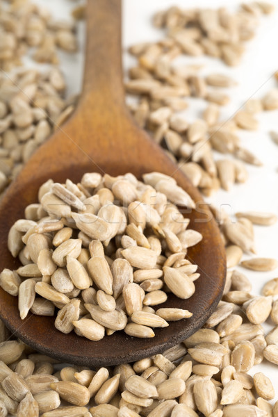 Stock photo: Shelled sunflower seeds in wooden spoon
