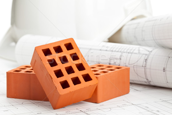 Bricks on construction plan Stock photo © ShawnHempel