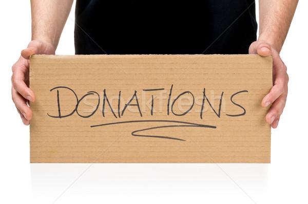 Man karton teken roepen donaties Stockfoto © ShawnHempel