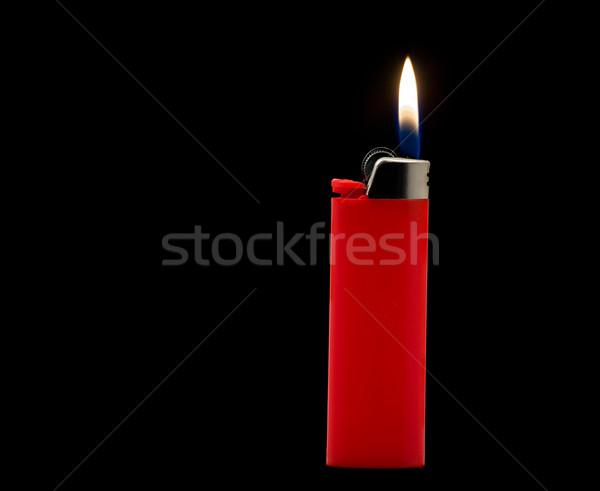 Isqueiro vermelho isolado preto fogo metal Foto stock © ShawnHempel