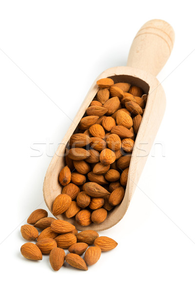 Cracked and shelled almond kernels in wooden scoop Stock photo © ShawnHempel