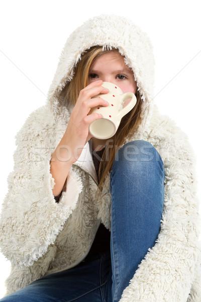 Fiatal lány farmernadrág tél kabát ül tart Stock fotó © ShawnHempel