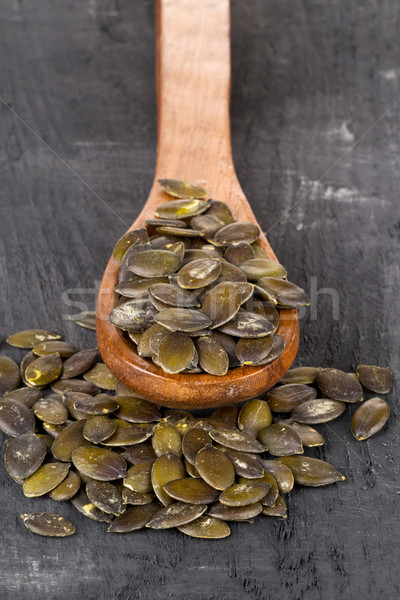 Unshelled pumpkin seeds in wooden spoon Stock photo © ShawnHempel