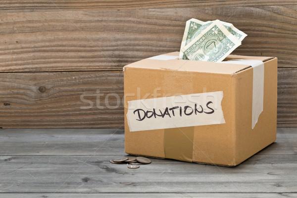 Foto stock: Doação · dólar · notas · moedas · cartão